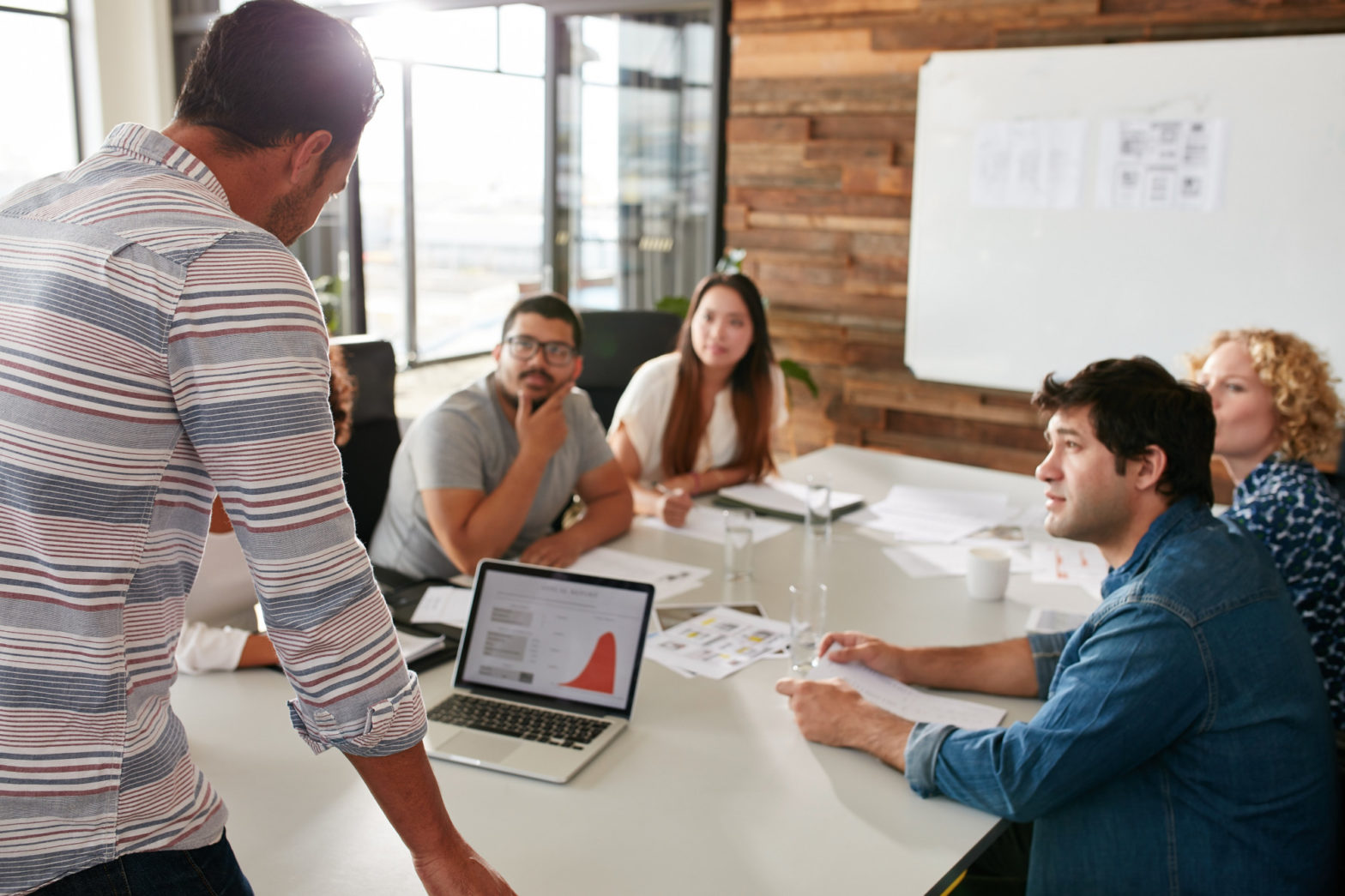 Young man giving business presentation to colleagues