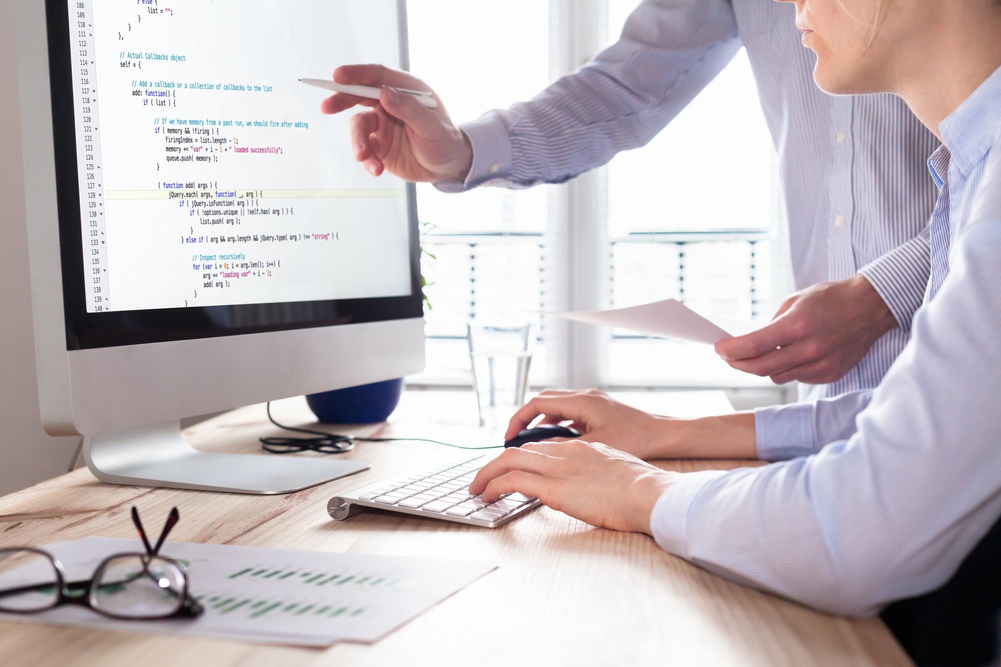 web app developers coding website source code, debugging